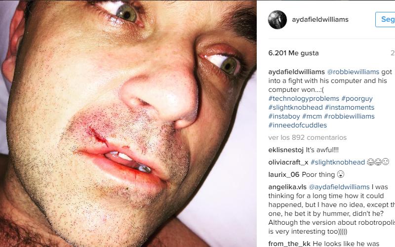 Robbie Williams a las piñas con la compu